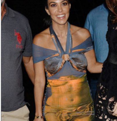 Kourtney Kardashian chose to wear an iconic 90's Jean Paul Gaultier Nude Venus Sheer Goddess Dress from Morphew – the luxury vintage NYC retailer